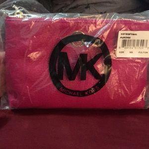 NWT Michael Kors Fuschia makeup bag!
